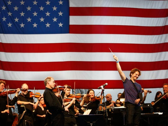 The Louisville Orchestra, with conductor Teddy Abrams, performs for the crowd at Louisville's 4th of July celebration at the Great Lawn.  