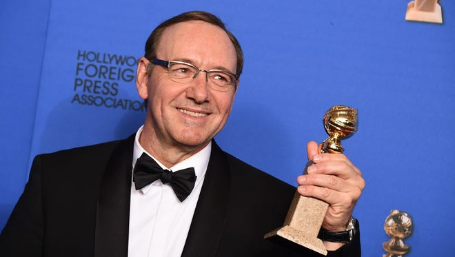 """Kevin Spacey poses in the press room with the award for best actor in a television series - drama for """"House of Cards"""" at the 72nd annual Golden Globe Awards at the Beverly Hilton Hotel on Sunday, Jan. 11, 2015, in Beverly Hills, Calif. (Photo by Jordan Strauss/Invision/AP)"""