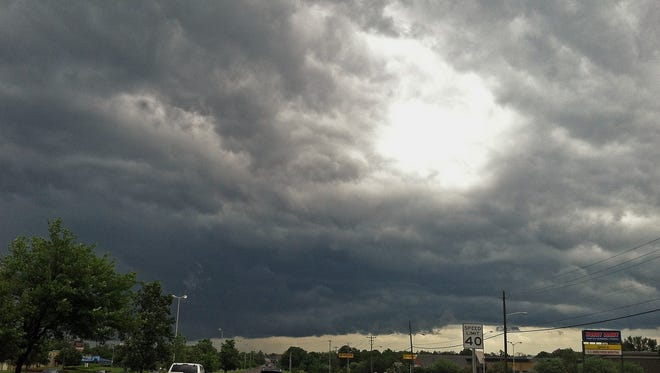 The storm front moves in Murfreesboro, Tenn. on Tuesday, May 21, 2013.