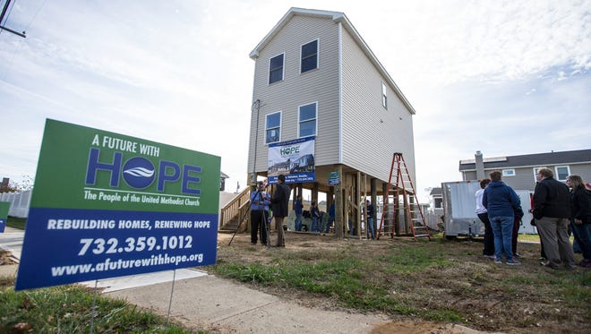 The nonprofit Sandy recovery organization 'A Future With Hope' celebrates a new home build on the four year anniversary of superstorm Sandy in Union Beach. Homeowner Jen Capraun is looking forward to returning home. Union Beach, NJSaturday, October 29, 2016.@dhoodhood
