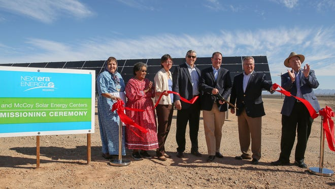 State and local officials, along with members of the Colorado River Indian Tribes, cut a ceremonial ribbon at NextEra's Blythe and McCoy solar farms in eastern Riverside County on Nov. 10, 2016. At far right is County Supervisor John Benoit.