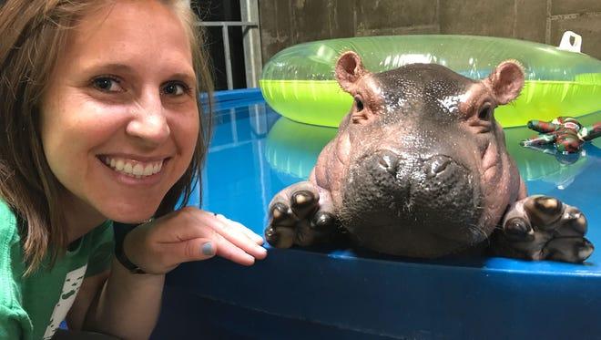 Cincinnati zookeeper Wendy Rice poses in  April 2017 with Fiona, a Nile hippo born prematurely Jan. 24, 2017, at Cincinnati Zoo & Botanical Garden.