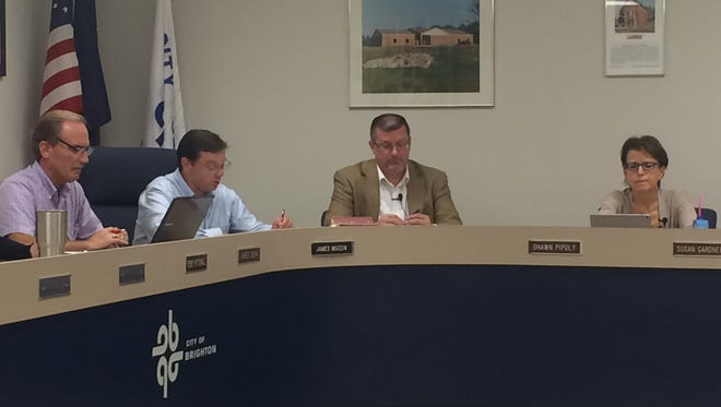 The Brighton City Council approved a plan Thursday for a new Candlewood Suites. Pictured, from left, Councilman Jim Bohn, Mayor Jim Muzzin, Mayor Pro Tem Shawn Pipoly and Councilwoman Susan Gardner. Councilmen Kristoffer Tobbe and Jon Emaus did not attend the meeting.