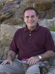 Kent Dana relaxes in the backyard of his Phoenix home