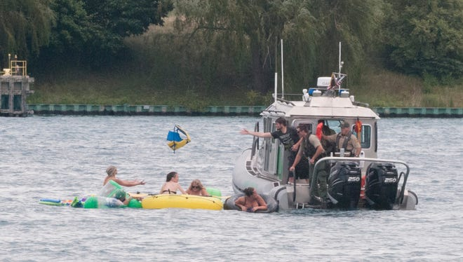 A Customs Border Protection boat helps floaters on the St. Clair River during Float Down Sunday, Aug. 21.