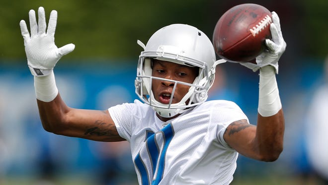 Detroit Lions wide receiver Teo Redding (10) turns after making a catch during practice at the Lions Headquarters and Training Facility on Tuesday, June 5, 2018.