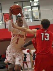 Princeton's Darius Bazley drives to the basket during