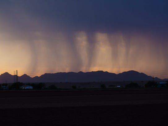 Bands of rain move over Phoenix during a monsoon storm