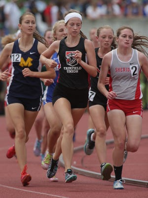 Sheridan's Anna Foster (right) runs the 3,200 during the Division II state track meet Saturday at Jesse Owens Memorial Stadium.
