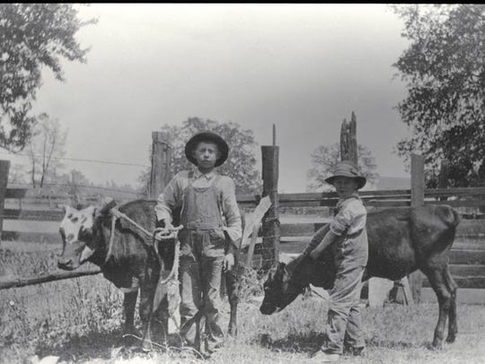 Lawrence (age 10) and Vernon Parsons (age 7); pictured