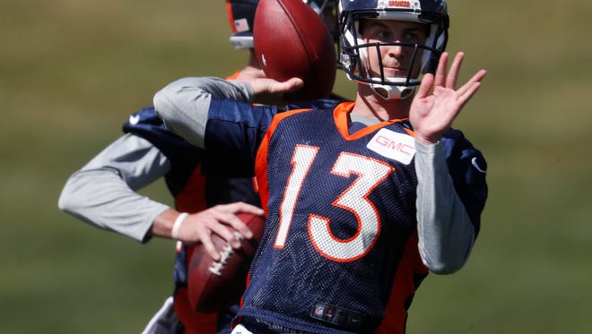 Denver Broncos quarterback Trevor Siemian takes part in drills during a voluntary veteran minicamp at the team' headquarters Tuesday, April 25, 2017, in Englewood, Colo. (AP Photo/David Zalubowski)