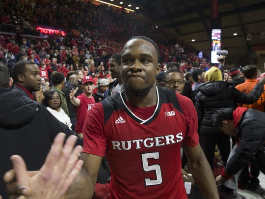 Rutger's Mike Williams celebrates with fans after game.Rutgers vs Seton Hall Basketball in Piscataway on December 16, 2017