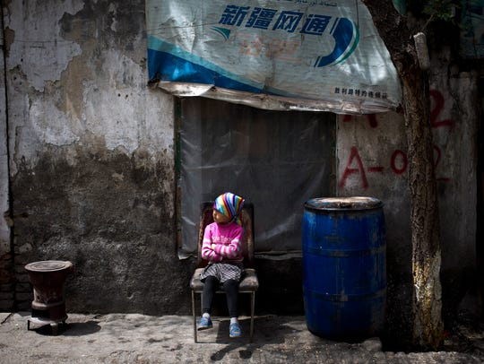 Child sitting on chair in China