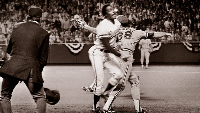 On Oct. 26, 1985, umpire Don Denkinger, left, looks on as Cardinals pitcher Todd Worrell, right, stretches out to catch the ball as Royals batter Jorge Orta steps on the base during the ninth inning in Game 6 of baseball's World Series.