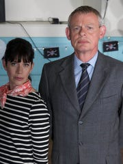 """Martin Clunes as the title character of """"Doc Martin,"""" with Caroline Catz, who plays his wife, Louisa."""