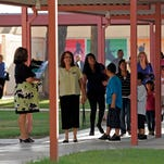 The Coachella Valley Unified School Board tabled a layoff vote on Thursday night, delaying a decision on the fate of 54 teaching jobs until a special meeting next Tuesday.