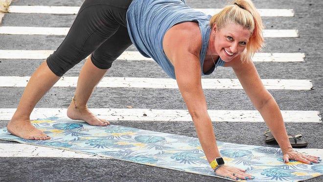 Marlo Alleva demonstrates a downward dog stretch.