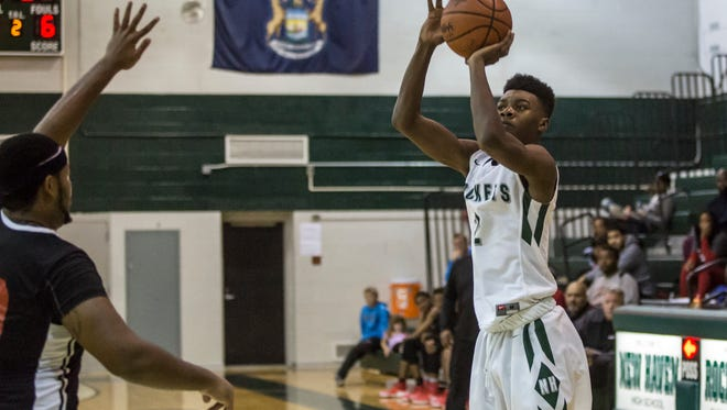 New Haven senior Eric Williams Jr. takes a shot during a basketball game Thursday, Dec. 29, 2016 at New Haven High School.