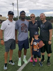 Matt Zobel (right) along with a few coworkers and Denver Broncos cornerback Bradley Roby.