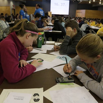 Team Wilson participates in a competition Tuesday,