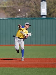 Bloomfield's Rogelio Gonzales fires to first base for