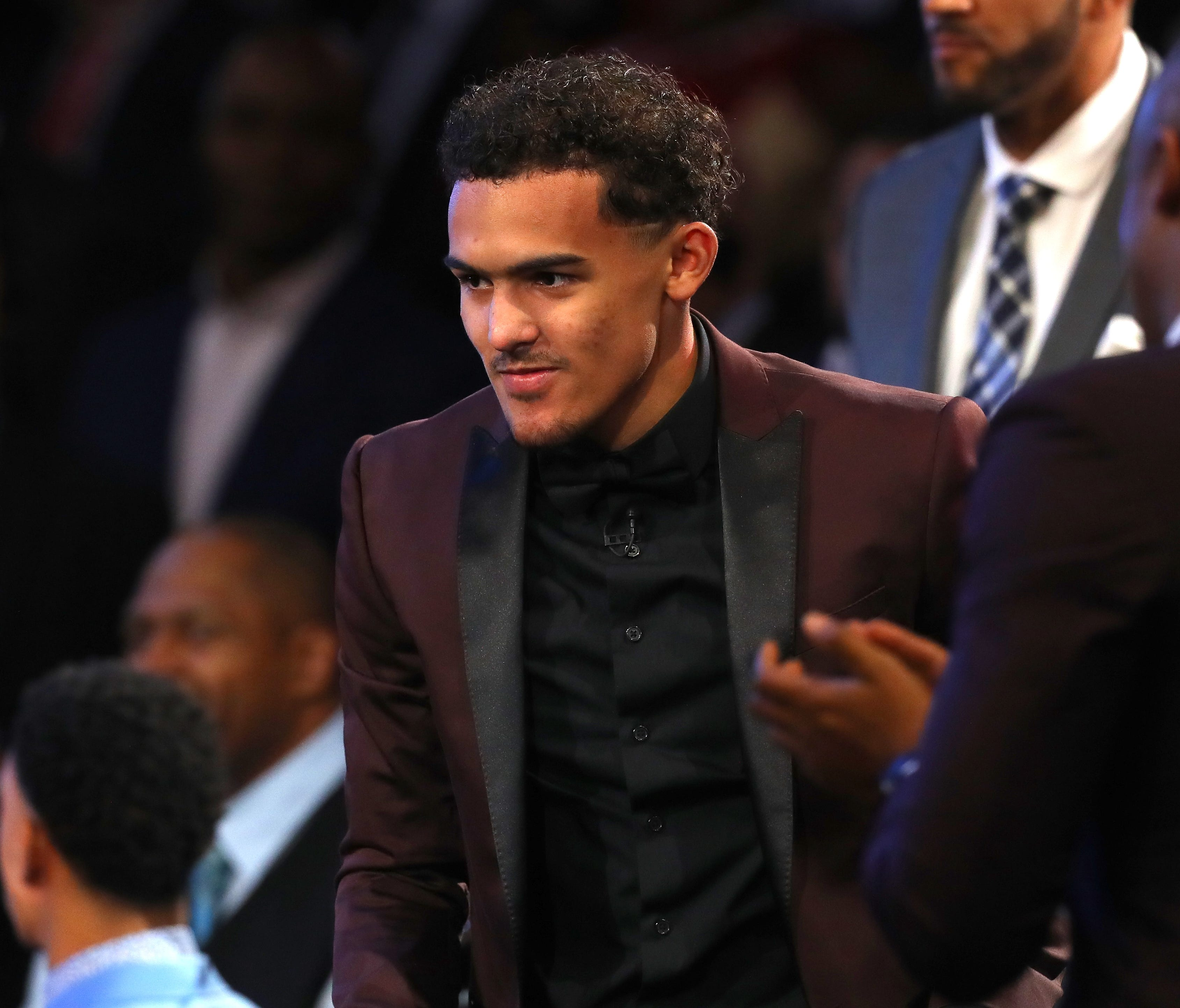 Trae Young reacts after being drafted fifth overall by the Dallas Mavericks during the 2018 NBA draft.