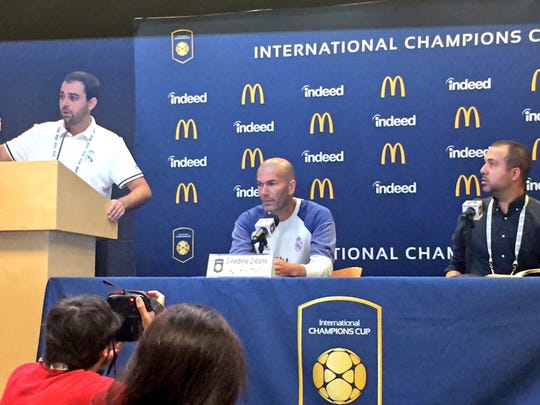 Real Madrid coach Zinedine Zidane, center, speaks about the Real Madrid-Chelsea match on July 29, 2016, at Michigan Stadium.
