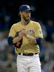 John Axford saved 106 games over five seasons with the Milwaukee Brewers.
