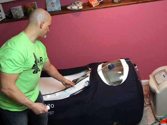 Jim Raffone shows the oxygen chamber that his 6-year-old son Jamesy spends two hours a day in at their Manalapan home. Jamsey has a rare, terminal form of muscular dystrophy called Duchenne.