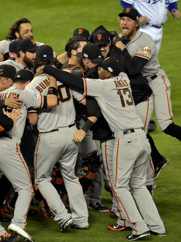 San Francisco Giants players celebrate on the field