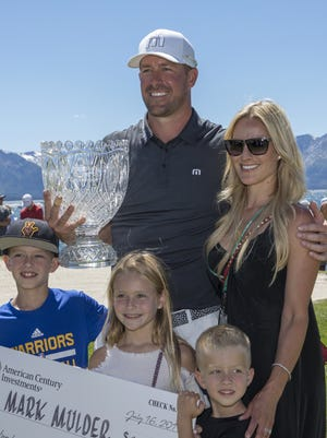 Mark Mulder poses with his family after winning the American Century Championship for the third year in a row at Edgewood Tahoe Golf Course in Stateline on July 16, 2017.