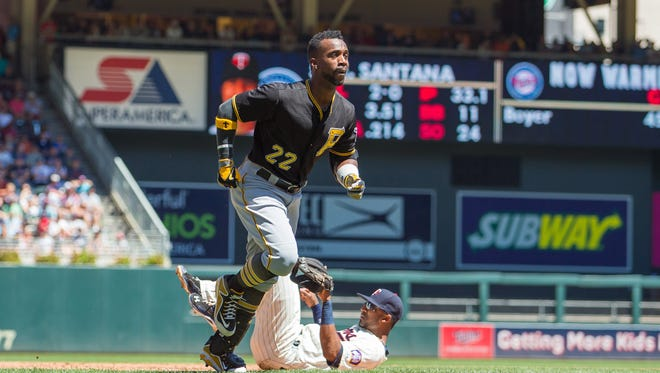 Andrew McCutchen walks home after Twins third baseman Eduardo Nunez gets called for runner interference in the sixth.