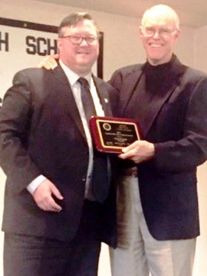 Outgoing Northville coach Greg Durham (left) received the 2015-16 Michigan High School Lacrosse Coaches Association's award.