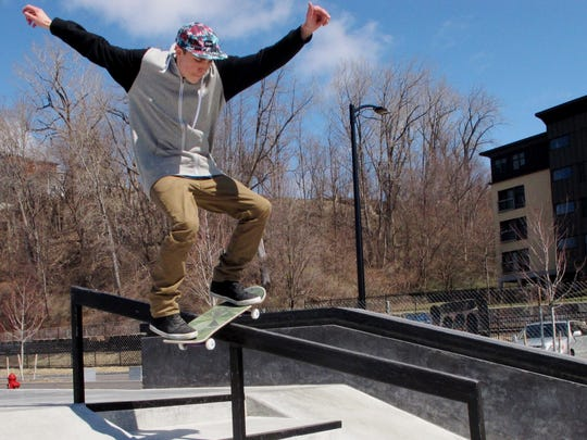 Ezra Wickwire, 22, of Warren, rides a handrail Saturday at the Burlington waterfront skatepark.