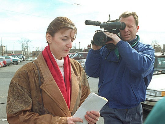 Michelle Lodzinski leaves the federal courthouse after