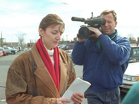 Michelle Lodzinski leaves the federal courthouse after being sentenced for faking a kidnapping.