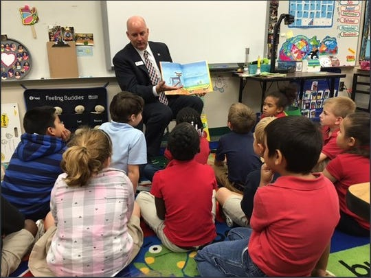 Indian River County Schools Superintendent Mark Rendell, shown in this undated photo reading to children, was honored by James Madison University in 2018 with its Ronald E. Carrier Alumni Achievement Award.