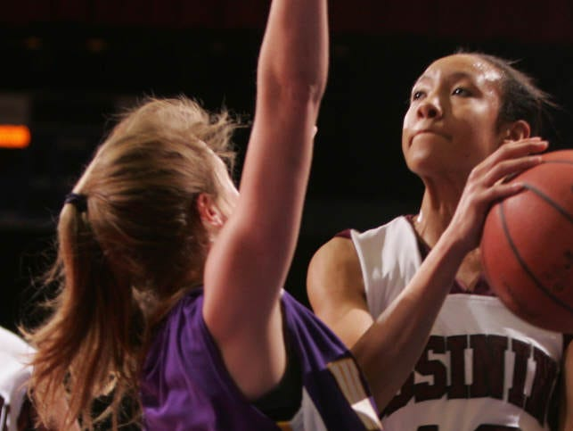 Ossining's Saniya Chong puts up a shot on Warwick's Taylor Baldwin during a Class AA regional semifinal girls basketball game at the Westchester County Center in White Plains March 8, 2011.