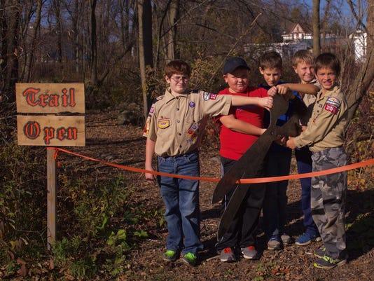 Cub Scouts cut Riverwalk trail ribbon