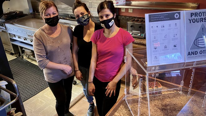 Rosaria Andrade, left, and daughters Kim and Kelly say their Rosaria's Diner on Rodman Street has fared well despite Covid-19 restrictions.
