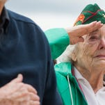 Jeanette Hodges salutes during the playing of Taps at the Memorial Day ceremony at Veterans Plaza in Spring Canyon Community Park Sunday, May 24, 2015 in Fort Collins, Co. Hodges served in the Marine Corps during World War II from 1943-1945 in North Carolina, drafting aircraft drawings for military use.