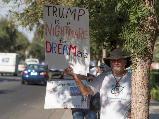 Ron Schafer of Fresno stands along Tulare Avenue with
