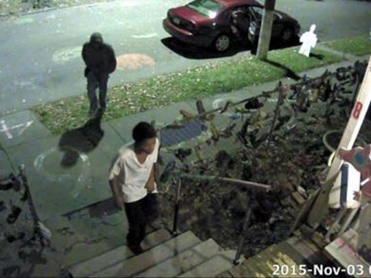 Surveillance video shows suspects breaking into a house at the Heidelberg Project at about 2 am Nov 3.