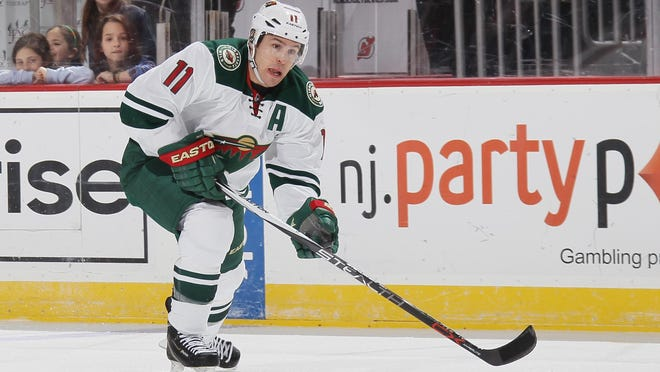 Zach Parise #11 of the Minnesota Wild skates against the New Jersey Devils at the Prudential Center on March 17, 2016 in Newark, New Jersey. The Devils defeated the Wild 7-4.