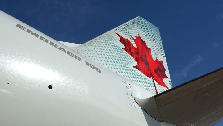 An image of an Air Canada Embraer E190 jet.