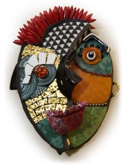 This asymetrical mosaic mask was created by Schwartz, who says masks and faces are among her favorite pieces to design.