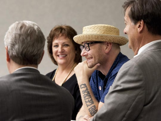 "Commencement speaker Mike Doughty, center, sits with judges Gary Johnson, left, Jennifer Shirk and Gary Paden before the Tulare County Adult Drug Court Graduation on Monday, June 22, 2015. Doughty is a songwriter, poet, author of ""The Book of Drugs: A Memoir"" and the former lead singer of Soul Coughing."