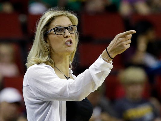 FILE - In this July 12, 2017, file photo, Seattle Storm head coach Jenny Boucek gestures during a WNBA game against the Connecticut Sun, in Seattle. The Seattle Storm have fired Jenny Boucek and promoted assistant Gary Kloppenburg to interim head coach for the remainder of the season.The team announced the moves Thursday, Aug. 10, 2017. The Storm (10-16) have lost four straight games and are fighting to make the playoffs. (AP Photo/Elaine Thompson, File)