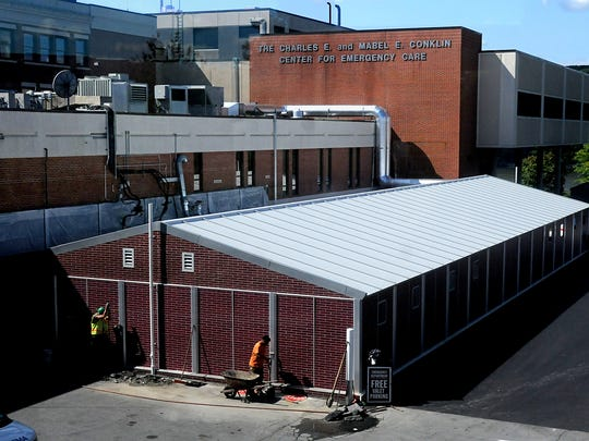 The new $2 million, 7,000 square-foot, 15 bay north annex to the Charles E. and Mabel E. Conklin Center for Emergency Care at Vassar Brothers Medical Center, pictured at bottom with metal roof, raises the total number of emergency care bays to 57 at the hospital.