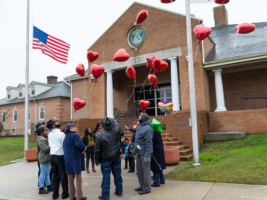 Tyson Henry's family members release heart-shaped birthday balloons to end a rally in front of the Dover Police Department on what would have been Tyson's 27th birthday.